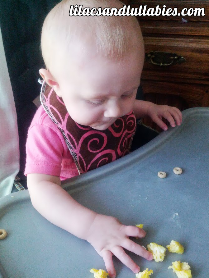 Aerilyn eating her egg and cheese mini muffins